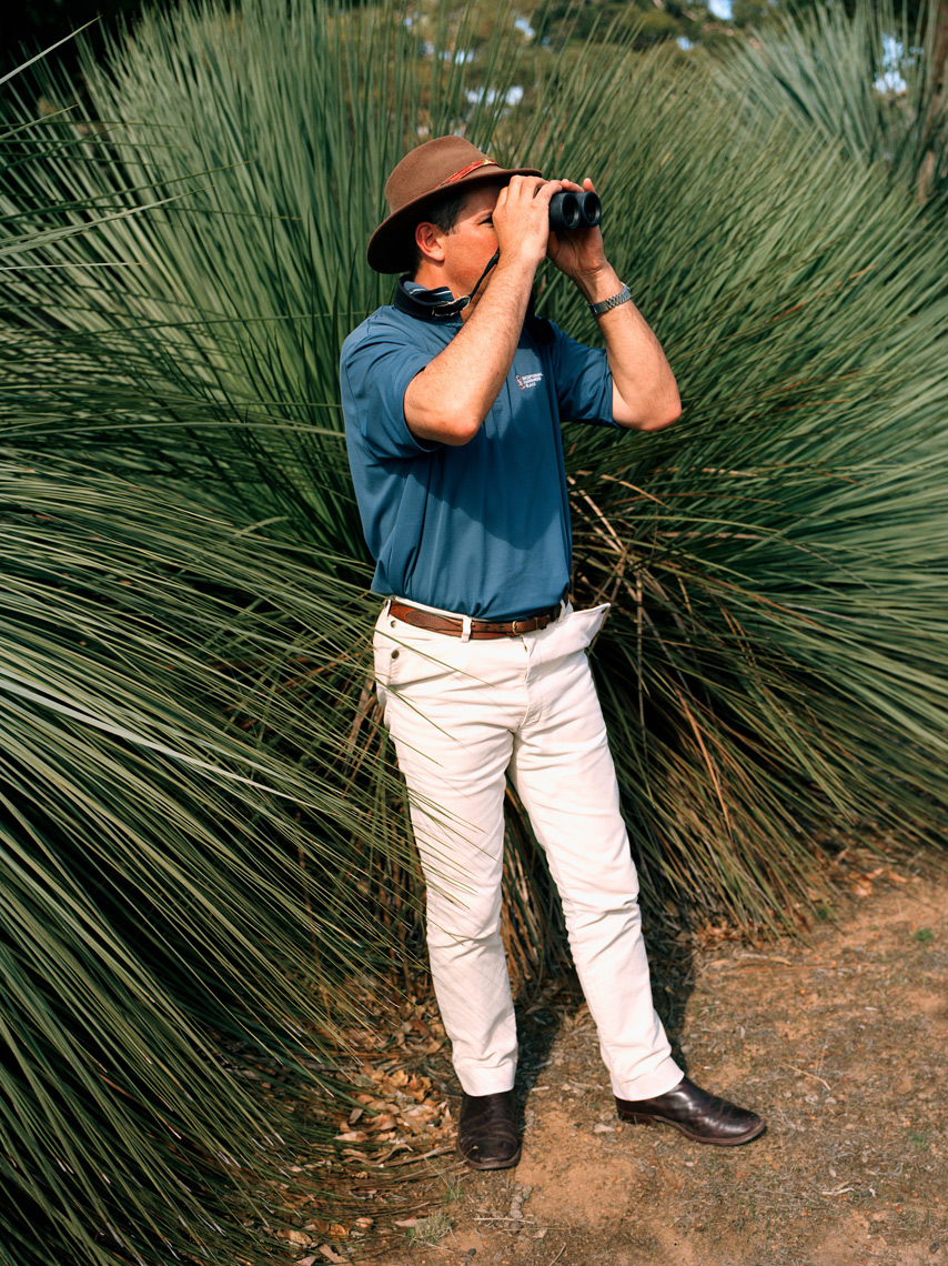 AUSTRALIA, Kangaroo Island, guide Craig Wickham, owner of Exceptional Kangaroo Island Tours, looking through binoculars