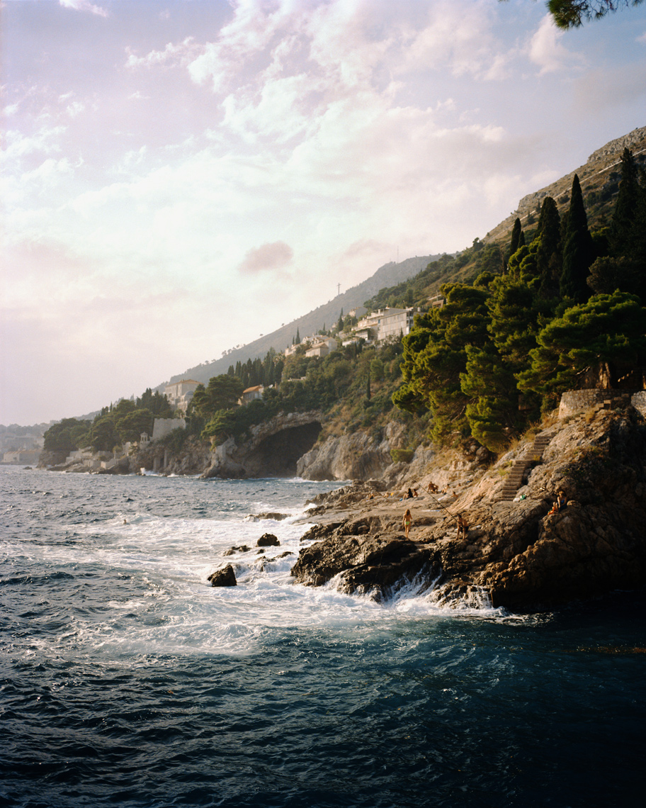 CROATIA, Dubrovnik, Dalmatian Coast, waves dashing on rocky mountain