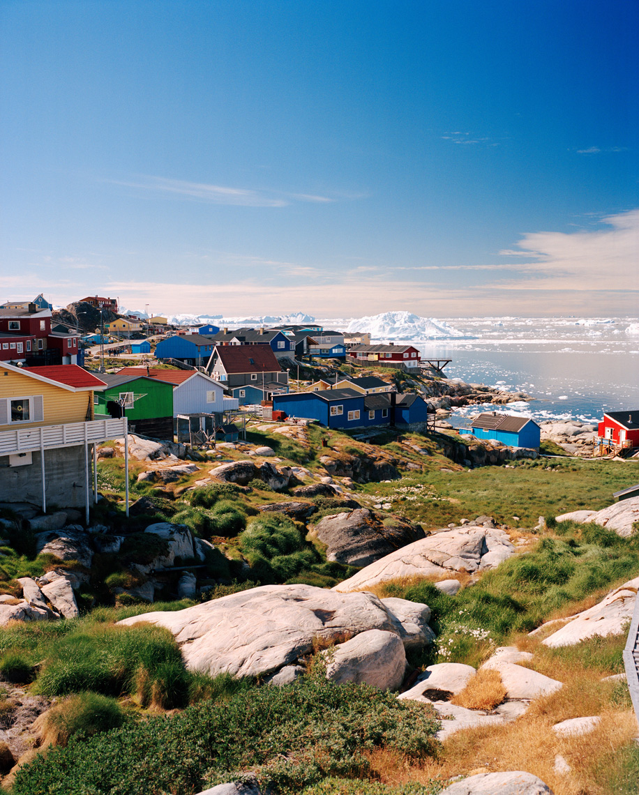 GREENLAND, Ilulissat, Disco Bay, exterior of houses with lake