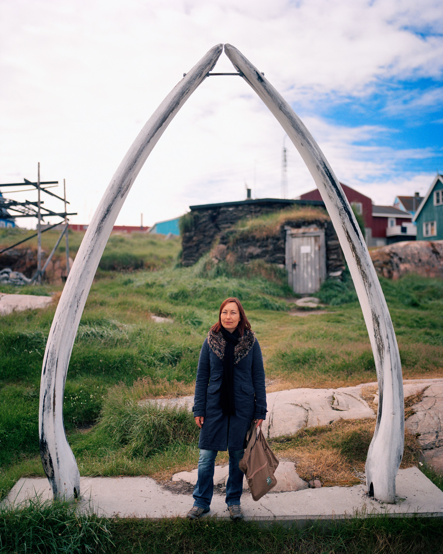 GREENLAND, Ilulissat, Knud Rasmussen Museum, portrait of young local with whale tusks