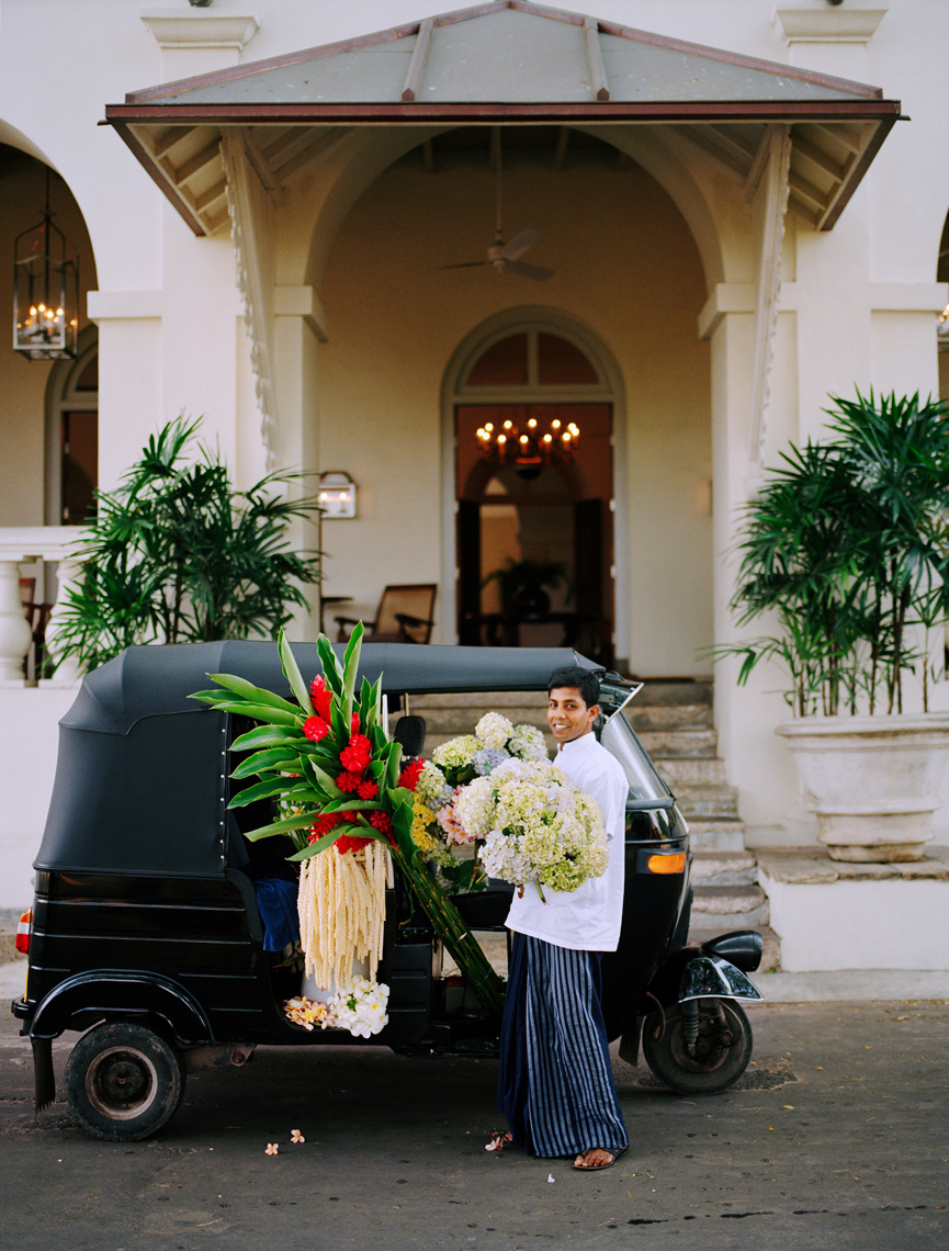 SRI LANKA, Asia, Galle, portrait of hotel staff holding flowers in front of the Amangalla Hotel in Galle.
